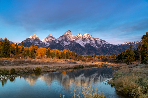 morning shot of grand teton after an autumn snowstorm from schwabacher landing in grand teton national park of wyoming, usa
