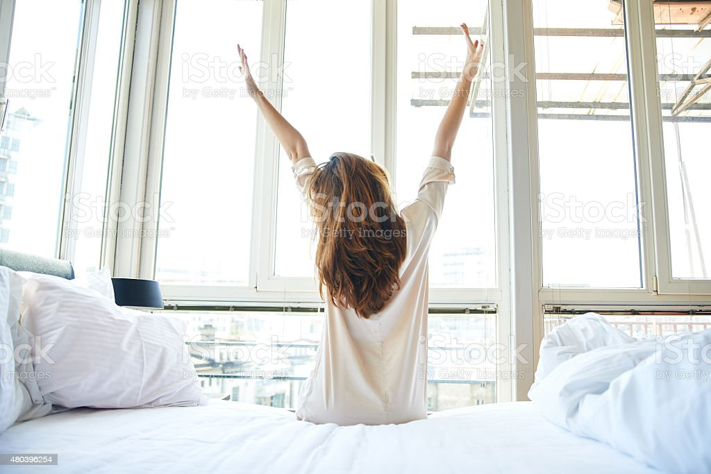Morning stretch in bed stock photo