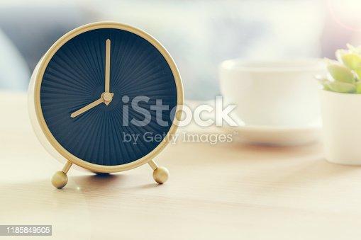 Morning sun. Alarm clock on a beautiful background