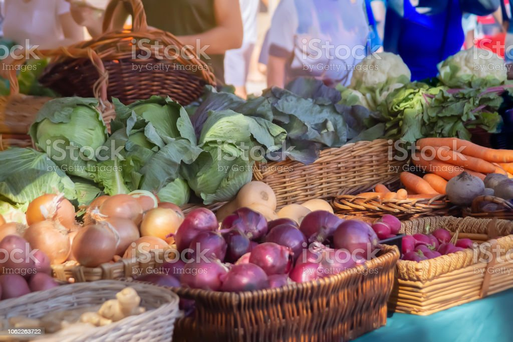 Morning sun cascades upon the display of produce at the Farmers Market. stock photo