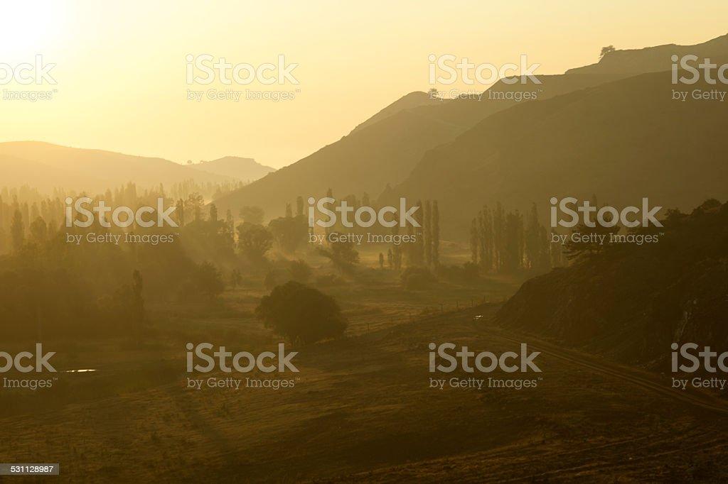 Morning sun in a landscape stock photo