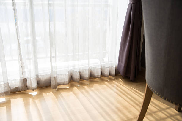 morning sunlight through curtain in room stock photo