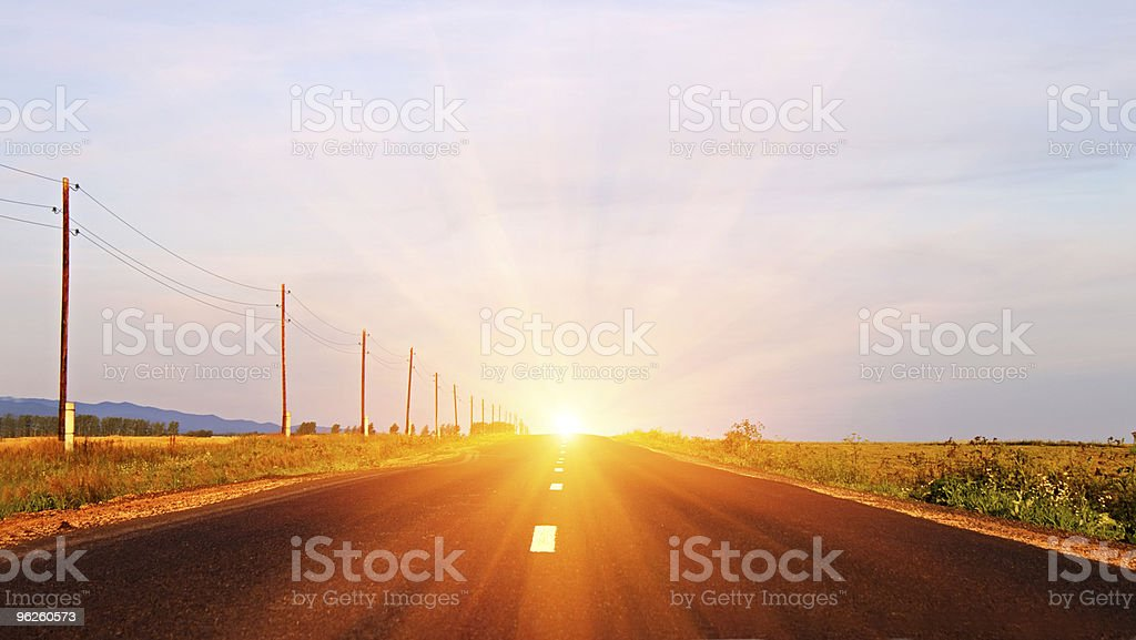 Morning Sunrise at a paved highway royalty-free stock photo
