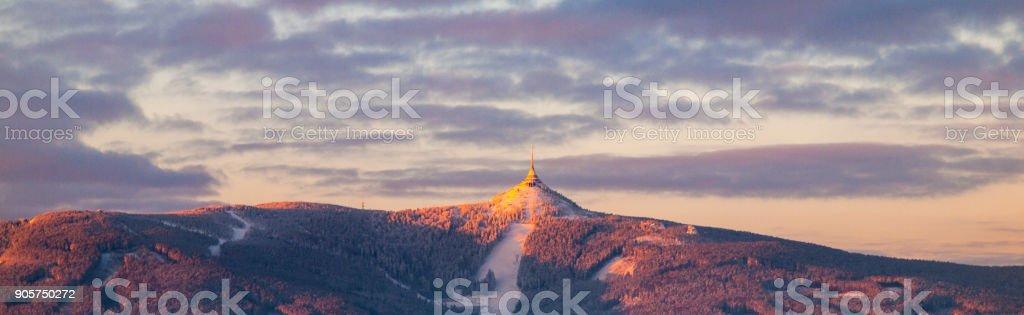 Morning sunrise at Jested Mountain and Jested Ski Resort. Winter time panorama. Liberec, Czech Republic stock photo