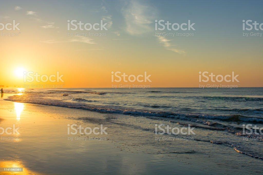 Morning sunrise on the beach stock photo