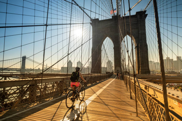 Morning sunrise on the Brooklyn Bridge in Manhattan New York USA stock photo