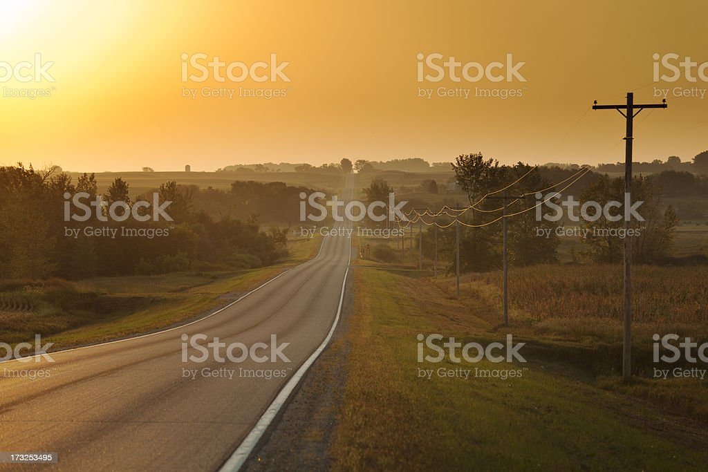 Morning Sunrise over Rural Farm Country Road stock photo