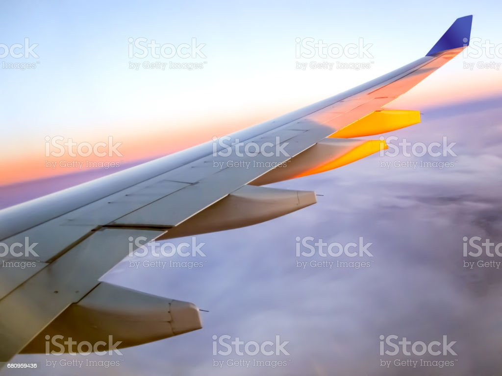 Morning sunrise with Wing of an airplane. Traveling concept royalty-free stock photo