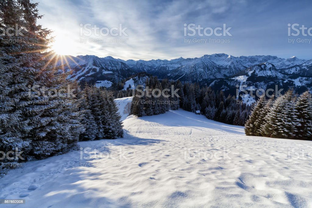morning sunshine in snowy Alps stock photo