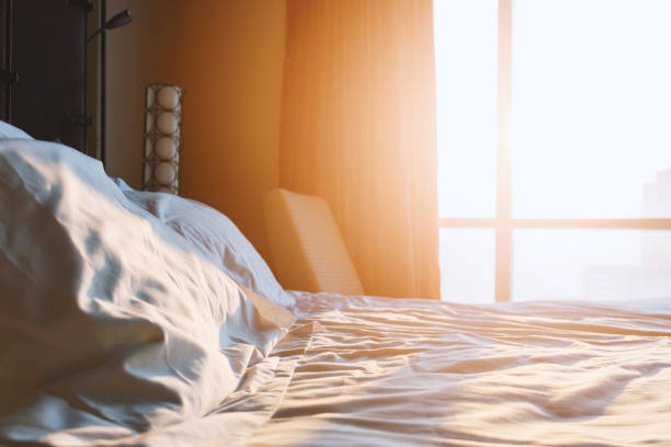 morning sunshine in the bedroom with soft-focus and over light in the background – zdjęcie