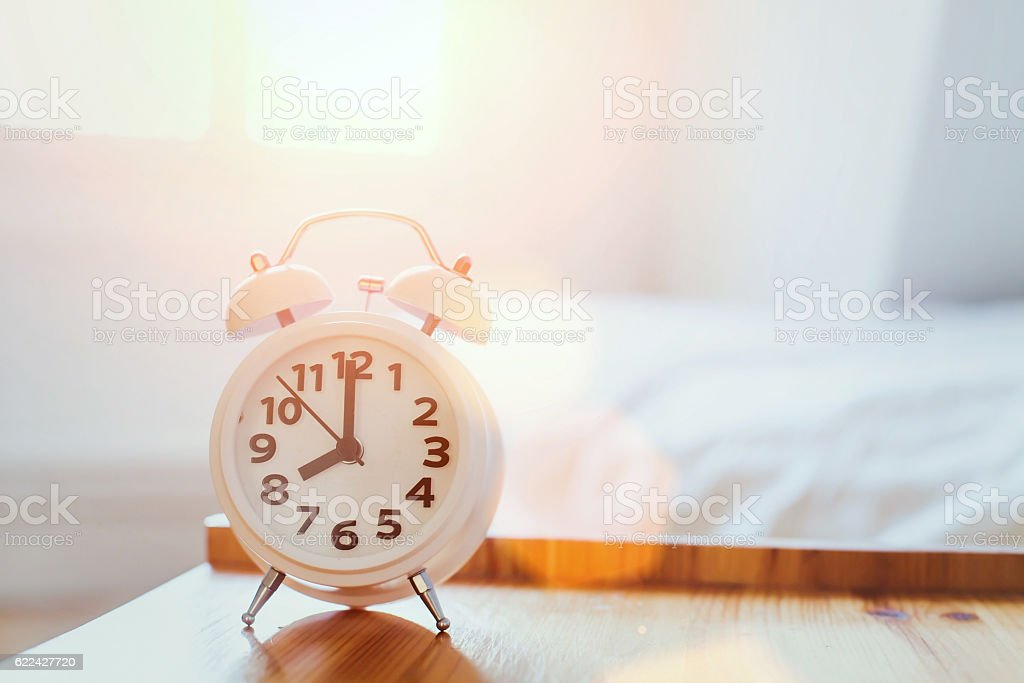 morning time background, alarm clock stock photo