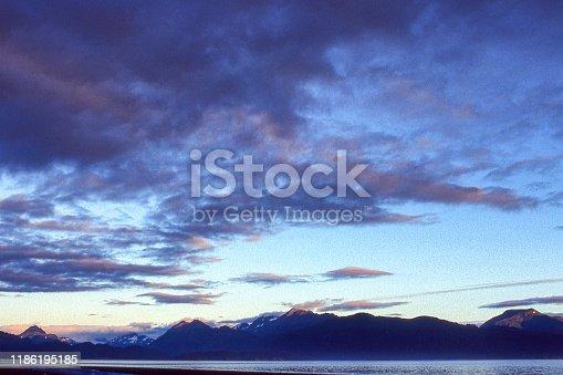 Moring view of Kachemak Bay under a cloudy sky  Taken in Homer, Alaska, USA