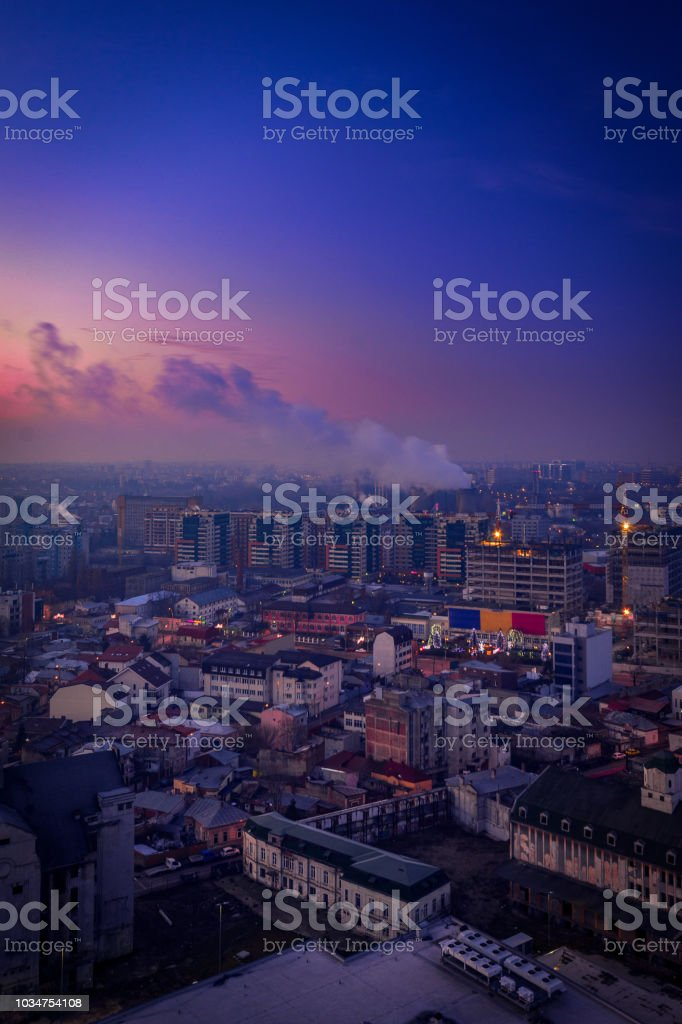 Morning view over the city from above during winter with a thermal energy plant making steam stock photo