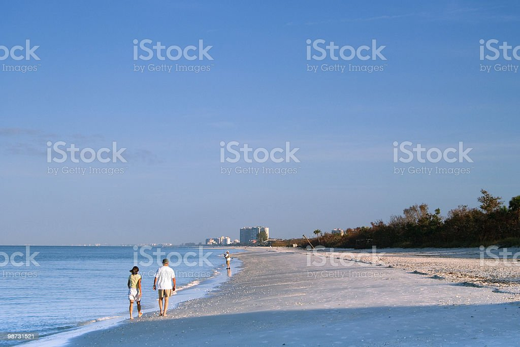 morning walk on the beach royalty free stockfoto