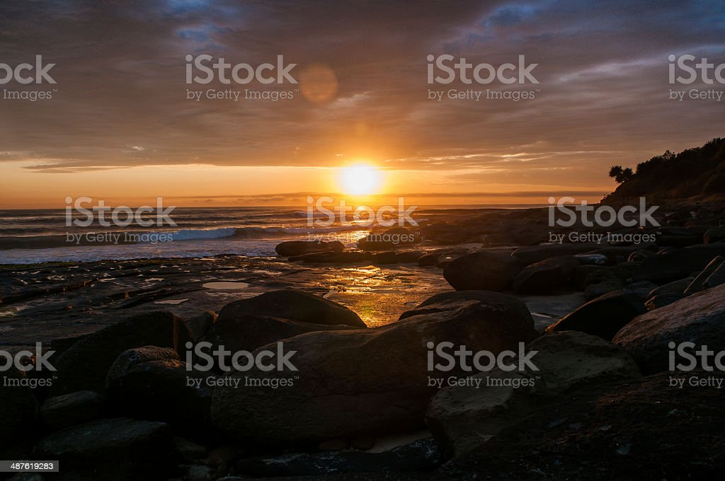 Morning warmth on the rocks stock photo