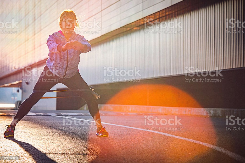 Morning workout with resistance band stock photo