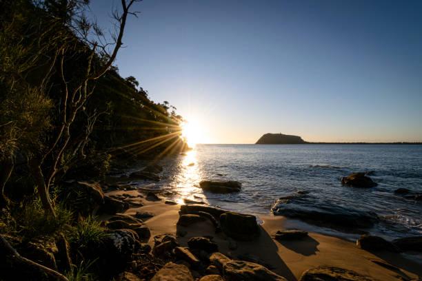 Morning_sun_on_private_beach stock photo