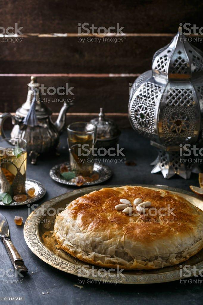 Moroccan chicken bastilla on copper plate, close view stock photo