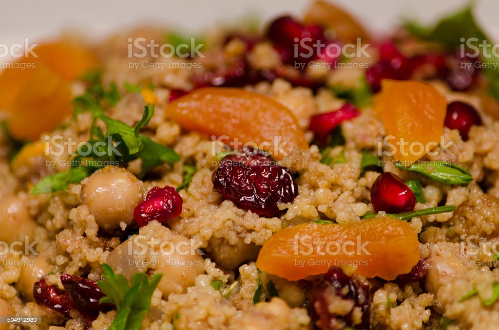 Moroccan Couscous with Chickpeas and Dried Fruit stock photo