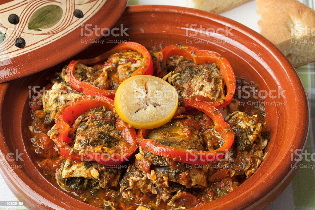 Moroccan fish tagine with chermoula stock photo