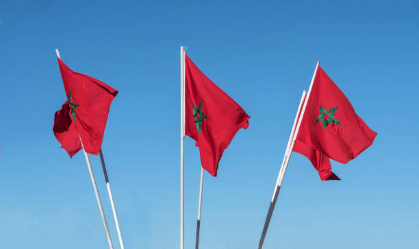 Moroccan flags against as blue sky stock photo