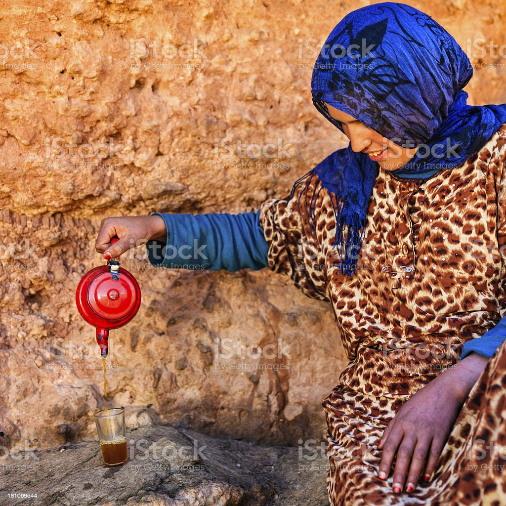 Moroccan girl preparing Maghrebi mint tea. royalty-free stock photo