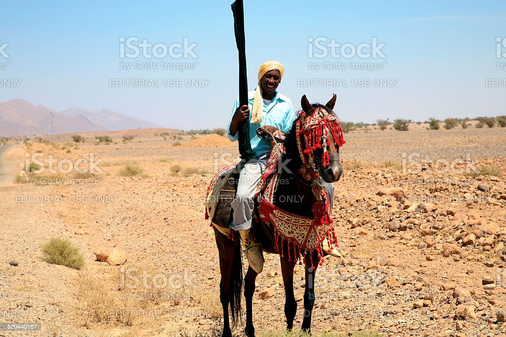 Moroccan horse rider on the road to Marrakesh stock photo