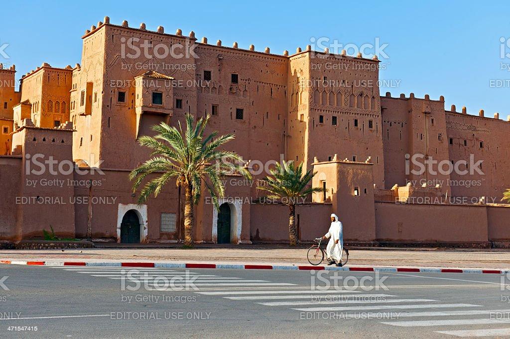 moroccan Man Passing Kasbah Taourit Ouarzazate Africa stock photo