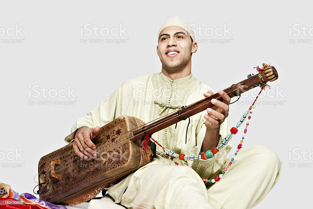 Moroccan Man Playing the Guembry stock photo