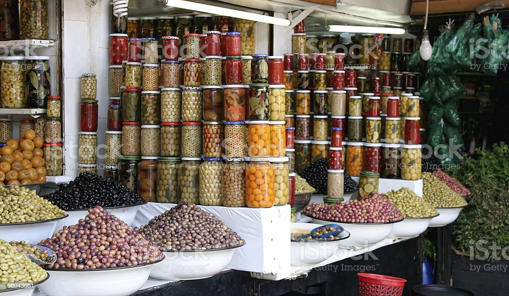 Moroccan market stand with olives and jars royalty-free stock photo
