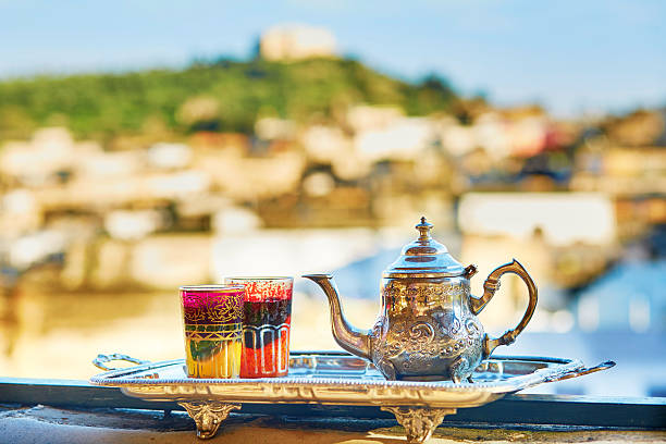 moroccan mint tea with sweets - north africa stock photos and pictures