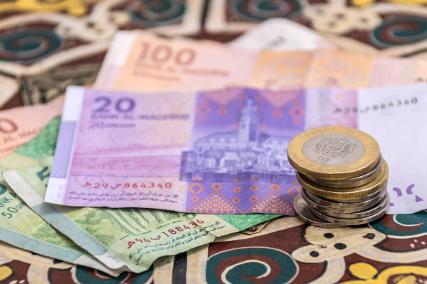Moroccan Money - Dirham Coins and Notes on a table stock photo