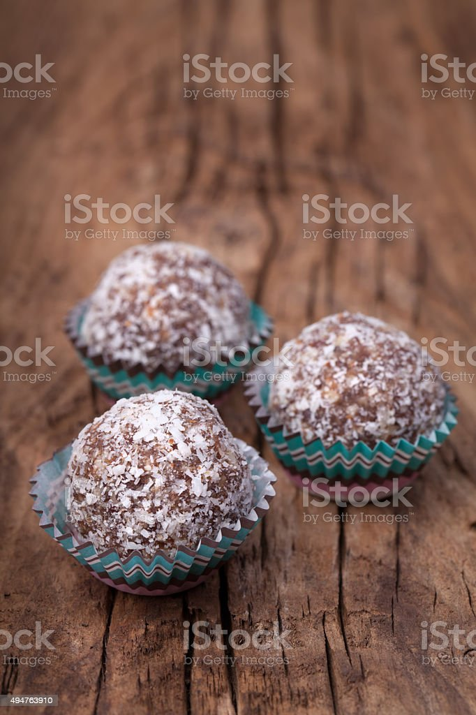 Moroccan organic sweet balls on an old rough wood stock photo