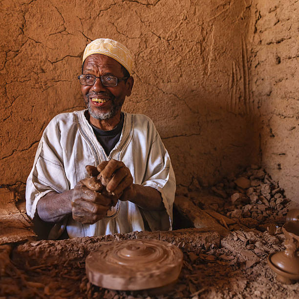 Moroccan potter working in his workshop stock photo