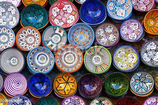 Essaouira, Morocco - October 1, 2018: Moroccan pottery in Essaouira. Colorful ceramics and pottery displayed outside a shop. Beautiful oriental design with plenty of colors.