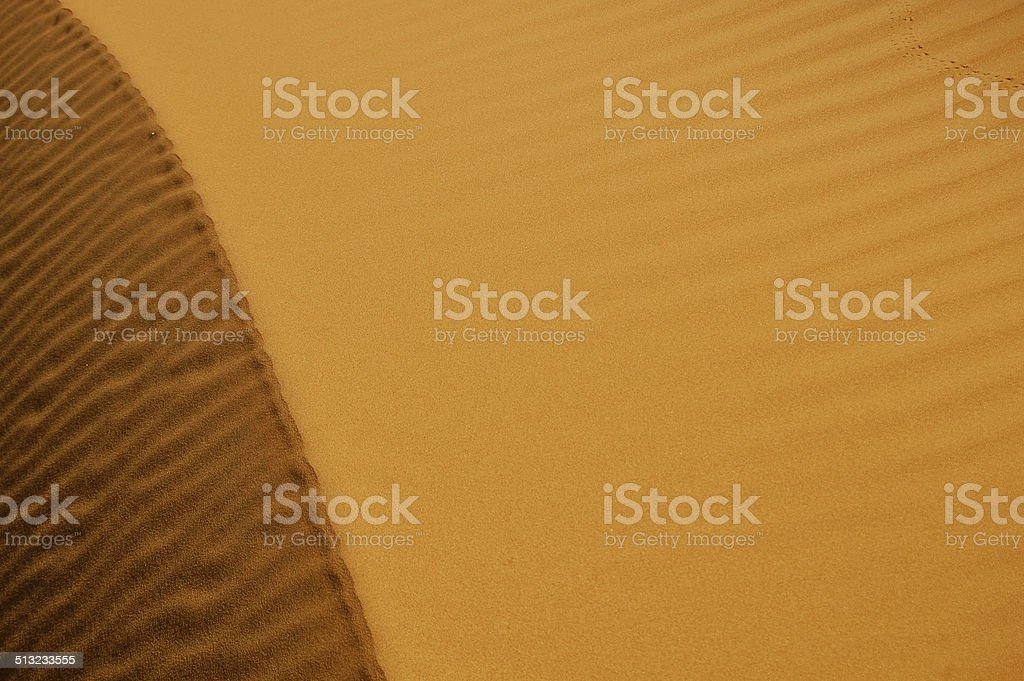 Moroccan Sand Dune with Ripples and Shadows stock photo