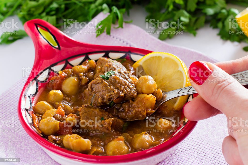 Moroccan soup harira with meat, chickpeas, lentil, tomato and spices stock photo