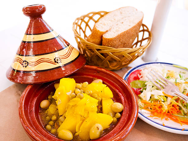 Moroccan Tagine in Fez Moroccan Tagine in Fez - potato & Chick peas served with Salad and fresh bread el tajin stock pictures, royalty-free photos & images