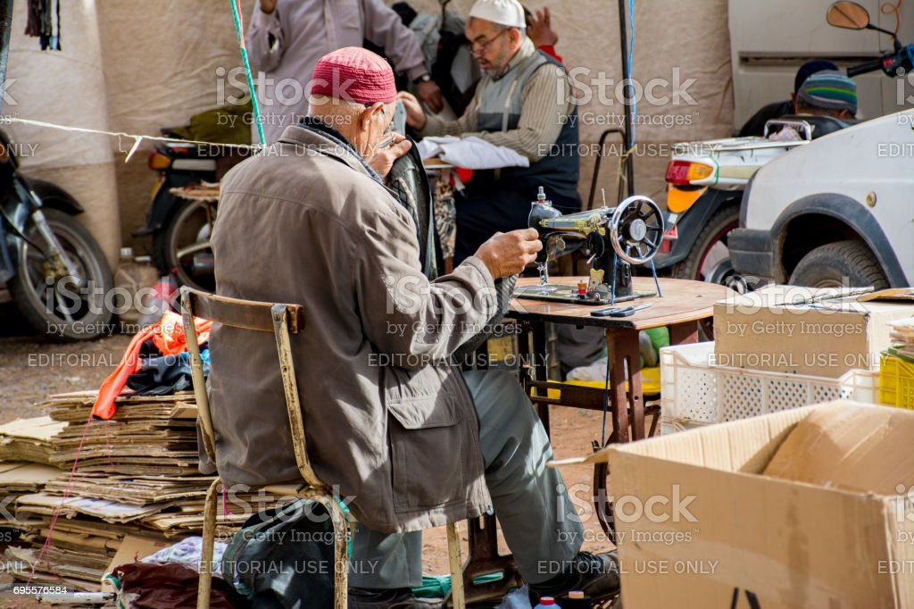 Moroccan Tailor Repairing Clothing stock photo