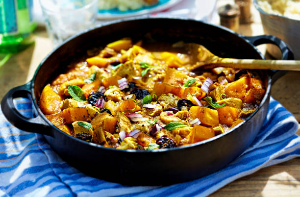 moroccan tajine - fried chicken with pumpkin, cherries and red onion - tagine stock-fotos und bilder