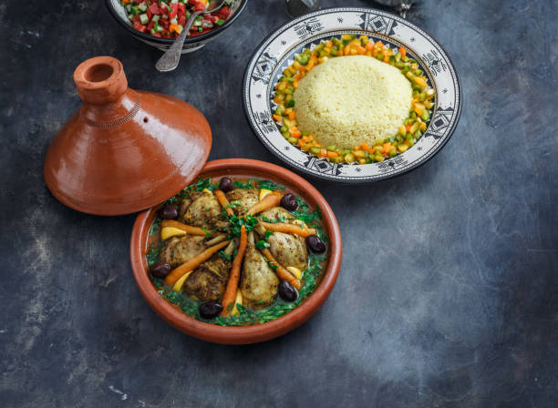 Moroccan tajine with chicken and carrots, copy space stock photo