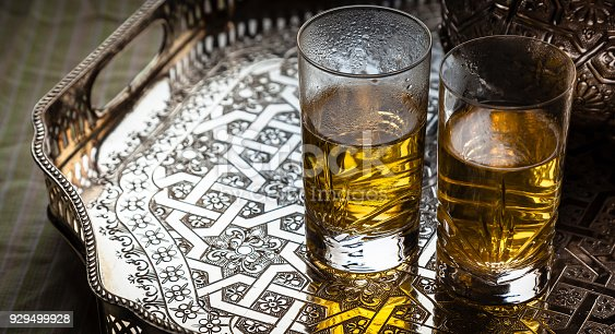 istock Moroccan tea gathering concept with 2 glasses 929499928