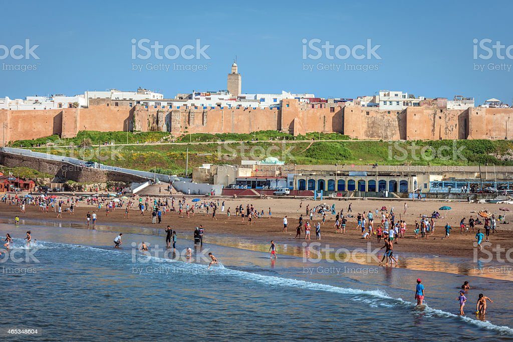 Moroccan woman and children playing at Kasbah beach, Africa stock photo