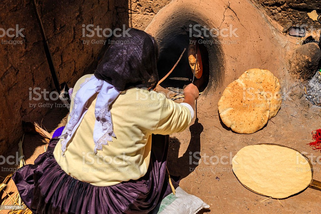 Moroccan woman making bread - khubz stock photo