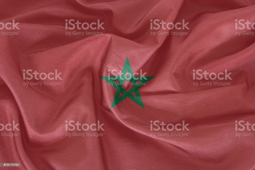 Morocco flag on the fabric texture stock photo