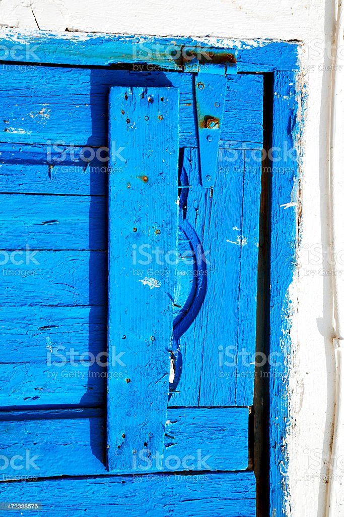 morocco in africa the old wood facade home and rusty safe padlock