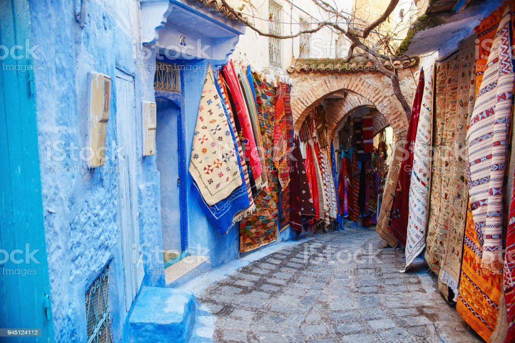 Morocco is the blue city of Chefchaouen, endless streets painted in blue color. Lots of flowers and Souvenirs in the beautiful streets of Chefchaouen. A magical fairy-tale city of heavenly color stock photo