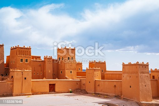 Fortress Kasbah Taourirt in a sunny day. Blue cloudy sky on the background.