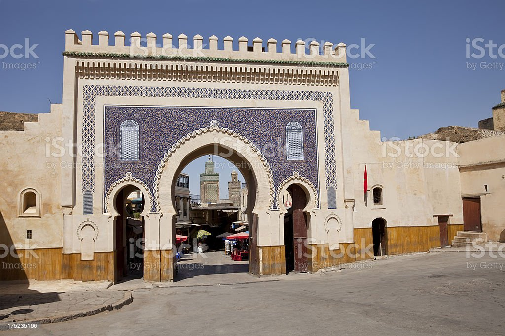 The Bab Boujeloud gate of passageway into city street in Fez, Morocco.