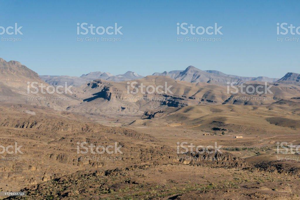 trekking man in mountains. Atlas mountains, Jebel Sakhro , Ourzazate,...